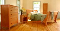Vermont made Shaker Bedroom Furniture Set. Set includes Shaker Sleigh Bed, two Shaker Night Stands, and one 6-drawer Shaker Chest, all made of natural cherry wood.
