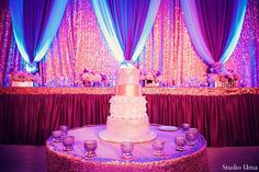 With gorgeous floral and decor and a sensational cake, this Indian wedding reception is a stunning event!