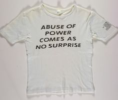 "Jenny Holzer - ""Abuse of power comes as no surprise."" You've seen the photo, etc. etc."