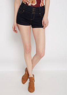 Make a warm weather escape and chill out in this playful high waist jean short! Fashioned with a dark blue wash, it's outfitted with light baking details. 3-shank and zip closure.