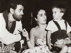 WHO'S THIS GUY WITH THE BEARD?  Rock Hudson, Elizabeth Taylor and her son Christopher Wilding