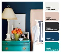 master bedroom colors. navy walls, black/white bedding, turquoise side table.