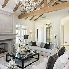 living room boasts vaulted ceiling adorned white living room with truss ceiling