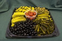 Relish Tray~ pretty much what mine looks like for Thanksgiving, although without the spicy peppers. No one eats those but me, so I keep them handy :-)