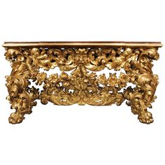 Italian Early 18th Century Baroque Giltwood Console | From a unique collection of antique and modern console tables at http://www.1stdibs.com/furniture/tables/console-tables/