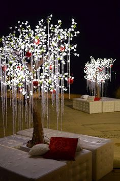 An LED Christmas tree might create a stunning display feature for your guests' seating table plan #weddingdecor