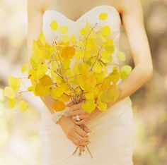 yellow leaf bouquet.  If I was going to have a fall wedding instead of a spring wedding I would use this idea and have some colorful leaves in my bouquet!