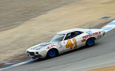 1972 Ford Torino racing in Group 6B (1959-1975 Grand National Stock Cars) at the 2010 Rolex Monterey Motorsports Reunion.