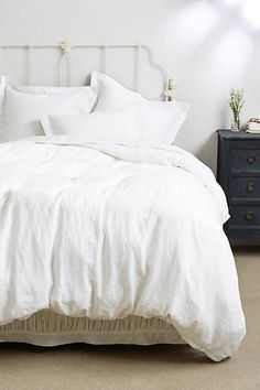 You just can't beat a gorgeous white bedspread! This linen bedspread from Anthropologie is so pretty! #anthropologie #whitebedding #affiliate