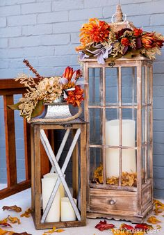 Turn outdoor lanterns into easy-to-update statement pieces. Just change up your faux foliage for year-round front door decor.