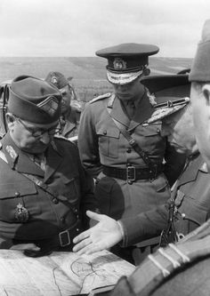 King Michael of Romania (center) watches as Prime Minister and Marshal Antonescu, Romania's effective dictator, discusses the strategic situation with staff officers during a visit to the front, 1941. Romania had contributed one army corps to the invasion of the USSR. King Michael is still alive in exile at 92.