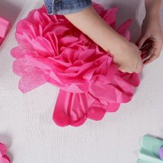 How to Make Giant Tissue Paper Pom-Poms Giant tissue paper balls are a party decor staple. If you need a bunch of pom-poms in a pinch, it's more affordable (and. Paper Flowers Craft, Flower Crafts, Diy Flowers, Flowers From Tissue Paper, How To Make Flowers Out Of Paper, Paper Flower Ball, Paper Flower Garlands, Pom Pom Flowers, Crepe Paper Roses