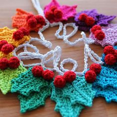 Want to make a rainbow crochet blanket? Fancy trying a myriad of new crochet stitches? I've made the pattern for my crochet blanket available, for free! Crochet Christmas Garland, Crochet Garland, Crochet Ornaments, Holiday Crochet, Christmas Knitting, Christmas Crafts, Holly Christmas, Crochet Bunting Free Pattern, Winter Christmas