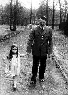 1936: Adolf Hitler and  Helga Goebels the daughter of Joseph Goebels... -Dark History-