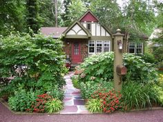 It's like the red front door is inviting you to walk the path and welcome home.
