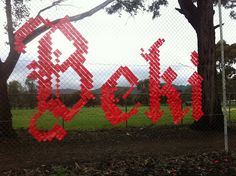 Made with tape on cyclone fence