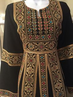 Black Dress / kaftan / Tobe / Thobe with bautiful golden Palestinian Cross… Afghan Clothes, Afghan Dresses, Embroidery Neck Designs, Embroidery Dress, Abaya Fashion, Ethnic Fashion, Easy Cross Stitch Patterns, Arabic Dress, Palestinian Embroidery
