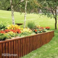 Instead of using stone or timbers, make an attractive, long-lasting retaining wall from pressure-treated plywood and trim boards. Construction is fast and simple, and the materials are much lighter to work with. How to Build a Retaining Wall - Summary Building A Retaining Wall, Concrete Retaining Walls, Garden Retaining Wall, Sloped Garden, Landscape Design, Garden Design, Front Yard Landscaping, Landscaping Ideas, Mulch Landscaping