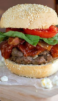 Blue cheese stuffed hamburgers are topped with a homemade chipotle bbq sauce, bacon, tomatoes and lettuce.