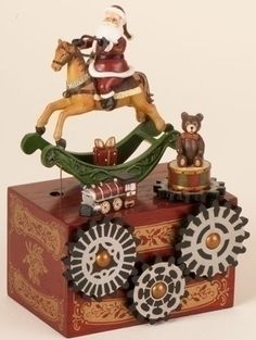 """$39.99-$49.99 8.5"""" Amusements Musical Animated Santa Claus on Rocking Horse - From The Amusements Collection  Item #36749  Delightful Christmas decor adds a splash of childhood whimsy to any room Santa figure sits atop a toy rocking horse that moves back and forth Gears and teddy bear also rotate Music box plays the tune """"We Wish You A Merry Christmas"""" Wind up feature on bottom of box    Dimensi ..."""