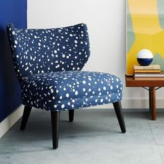 One of the best things you can do for a small living space is invest in a standout patterned chair. This one will definitely fit the bill.  BUY IT: Retro Wing Chair - Kate Spade Saturday Splatter Print, $499; West Elm