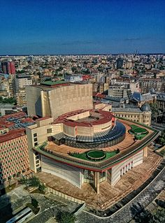 The building is the Bucharest National Theatre. And the shot was taken from the 21st floor of InterContinental Bucharest.