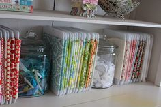 Fabric organization, roll fabric around the plastic and color coordinate (also I love the big jars full of ribbon scraps, I need to do something with my big box of ribbons!)