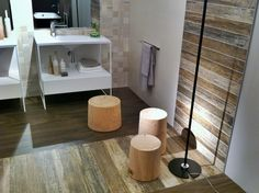 by Mariana Pickering (Emu Architects). Faux wood look ceramic tiles. Feature strip on floor and wall.