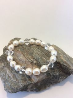 A personal favourite from my Etsy shop https://www.etsy.com/uk/listing/461315152/cultured-pearl-and-swarovski-bracelet