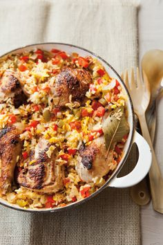 "Arroz Con Pollo:  WS:This classic Latin dish, which means ""rice with chicken"" is like a simplified version of paella. Saffron-infused rice is simmered with onions, peppers, and tomatoes and topped with pan-seared chicken for a simple and comforting one-pan meal."