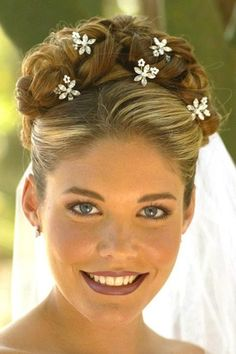 Wedding braided updo hairstyle with accessories
