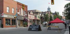 Downtown Huntsville, Ontario. 3 of the main shops are on the right. Copyright © 2012 by Macroknow Inc. All Rights Reserved.