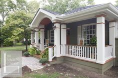 lovely ranch home front porch with white rocking chair   AFTER PICTURE