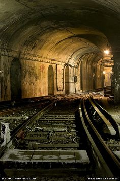 The ghost platforms and tracks of the abandoned Saint Martin metro station - Paris, France.