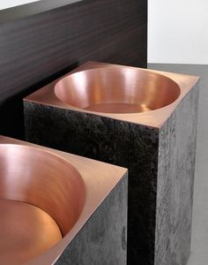 Copper and natural stone. Minotti's Euclide line: we can build a tile plateform and install a copper vessel for similar effect