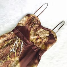 Guess by Marciano Reptile Print Dress So chic and perfect for a party! Brand new with tags. Color is champagne, brown and a hint of tan/bronze. Back zipper and adjustable straps. 96% polyester and 4% spandex. Stunning dress!! No Trades. TB1020. Guess by Marciano Dresses
