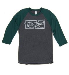 New script logo printed on a forest green and slate gray baseball tee. Unisex fit means it looks good on everyone. Made in the USA.