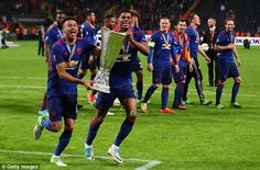Lingard and Marcus Rashford celebrate with the trophy following their Stockholm triumph...