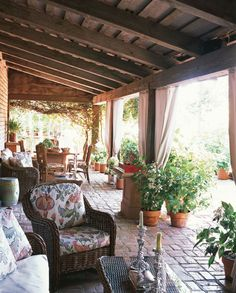 The curtained terrace offers shade on a 100-degree afternoon. The lush decor was inspired by the historic French villa.