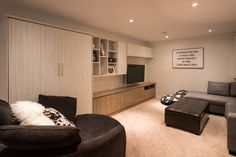 Whether it's a wall-bed for guests, or a media space for the family, this custom cabinetry works double time for this family of Modern Murphy Beds, Media Room Design, California Closets, Multipurpose Room, Bed Wall, Custom Cabinetry, Living Room Kitchen, Room Organization, Bed Design