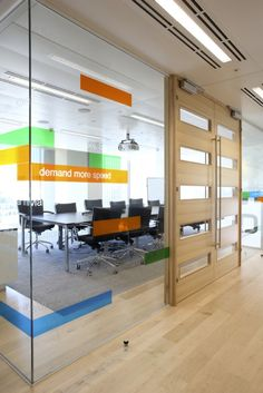 I like the signage on the glass along with the large wood doors.  Nice open conference room.