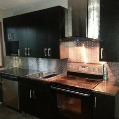 Metallic tiles highlight the kitchen's chrome cabinets. Source: Instagram user danika13xd