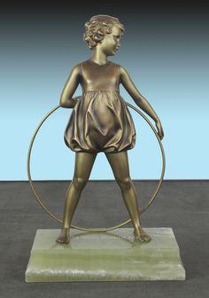 """An Art Deco  German bronze figure by Ferdinand Preiss,  circa 1930 """"hoop girl""""."""