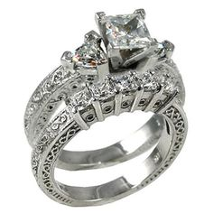 2.50 CTW Princess and Trillion Cut 3 Stone by MichaelSheaDiamonds, $339.95 I love antique looking jewelry.