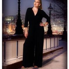 """HP 9/28GORGEOUS BLACK PALAZZO JUMPSUIT This jumpsuit is absolutely stunning. Can be dressed up or down depending on the occasion, so flattering. Polyester/rayon blend. Made in the USANWOT. PLEASE DO NOT BUY THIS LISTING! I will personalize one for you.♦️1X: bust 42"""" waist up to 38"""" hips 50"""" length from shoulder to hem 61"""" ♦️3X: bust 48"""" waist up to 42"""" hips 59"""" length 62"""" tla2 Other"""