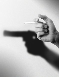 Smoking can be just as deadly as a gun.  Black and White Photography Gun Cigarette Shadow
