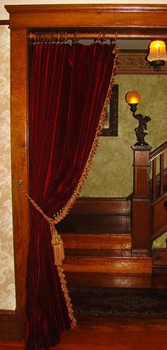ENTER UP: Tea parlor... Velvet curtains in doorway..very popular with Victorians. Love this idea.