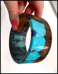 A wood and gemstone cuff bracelet by Freestone Peach Designs. This particular piece features peach wood with Kingman turquoise and copper.