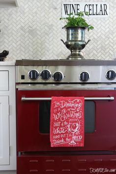 Love this red stove and white herringbone marble backsplash kellyelko.com