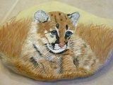 Original handpainted rock art, The Cougar has been hand painted on a large natural river rock that came from Arizona.  It measures 8 ½ x 5 ...